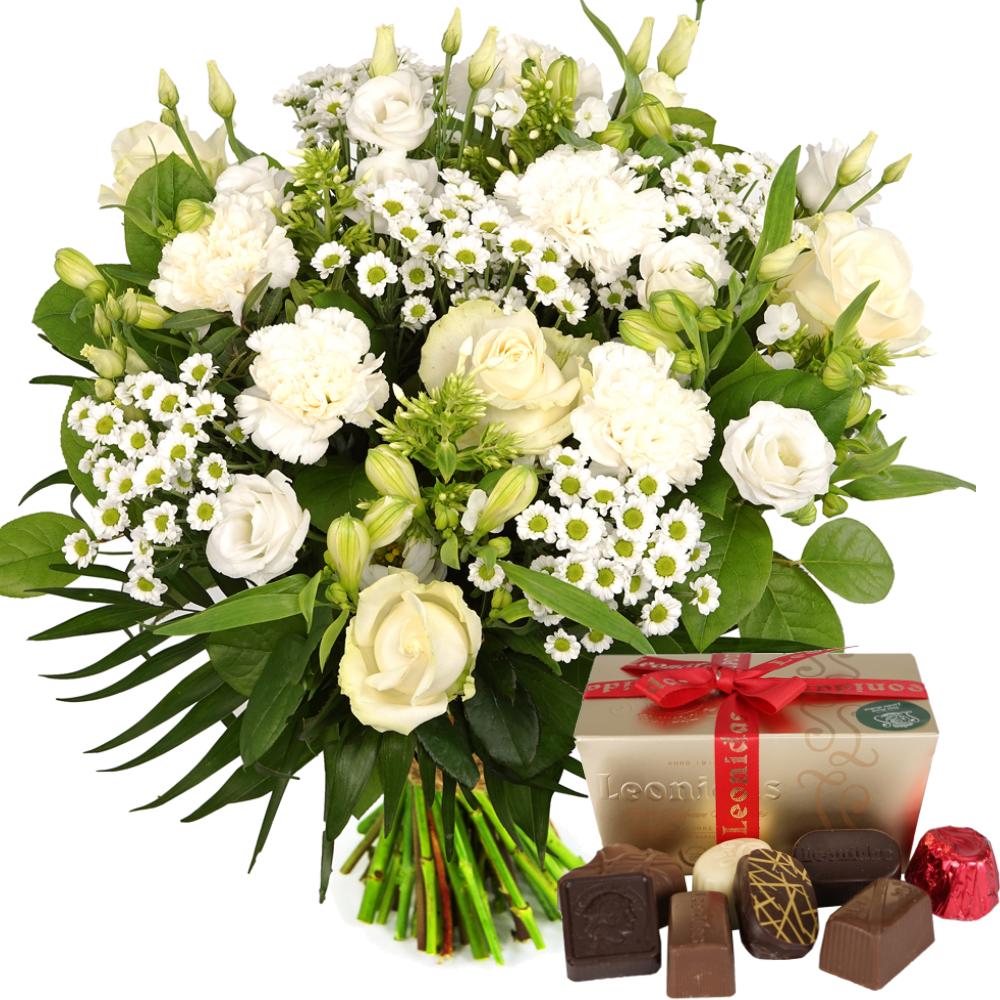 Witte bloemen met Leonidas bonbons