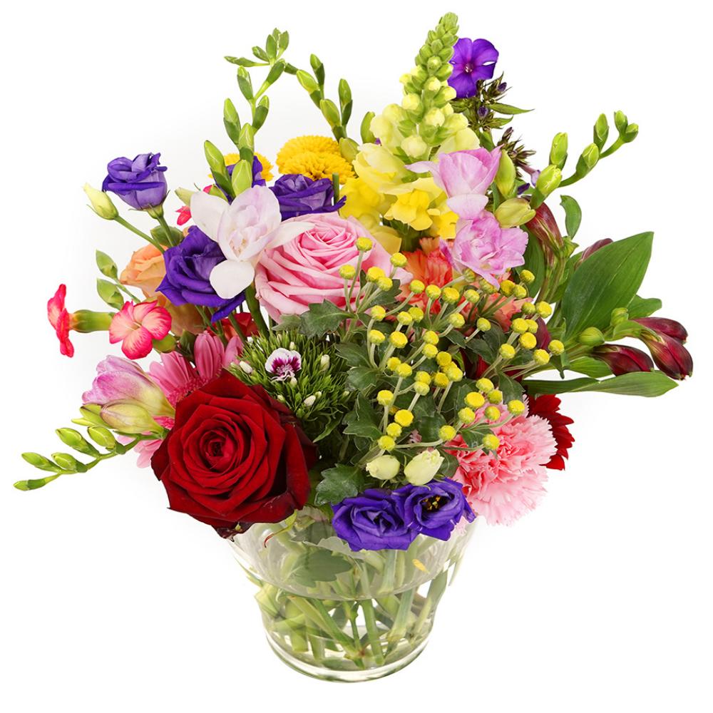 Bonte bloemen in glazen vaasje